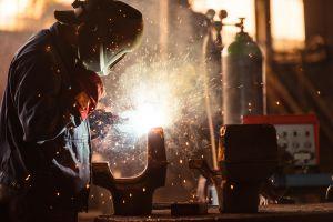 men welding lights workers