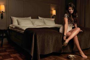 miniskirt closed eyes legs crossed high heels in bedroom brunette bedroom women sitting barefoot