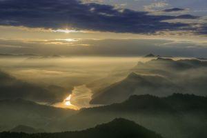 mist nature valley clouds river bridge sun rays landscape mountains