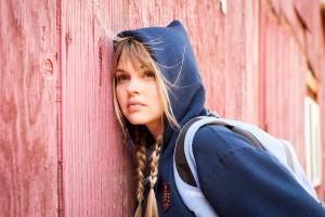 model juicy lips braids hoods wooden surface women outdoors backpacks blonde brown eyes windy depth of field looking away aimee teegarden long hair women
