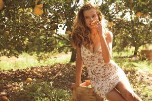 model long hair sunlight dress eating fruit tanya mityushina women outdoors women cleavage nature legs trees blonde