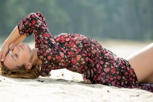 model stephanie beach lying on back women outdoors long hair hands on head arched back women closed eyes blonde sand nature windy rose