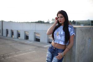 model torn jeans hands in hair women