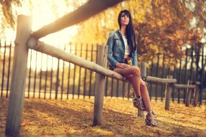 model women outdoors jean jacket black hair legs trees jacket leaves brunette long hair park fall sunlight nature high heels