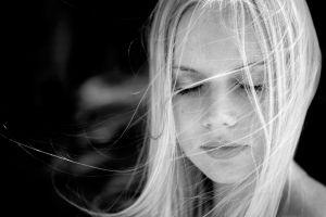 monochrome face women blonde hair in face portrait closed eyes