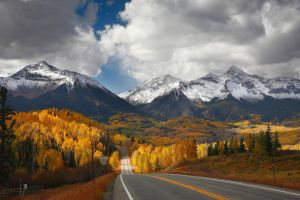 mountains clouds valley road fence landscape forest nature fall snowy peak