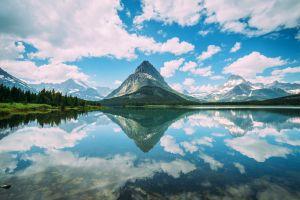 mountains glacier national park clouds montana nature landscape snowy peak lake reflection forest