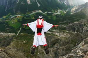 mountains jumping wingsuit sports nature helmet men basejumping bird's eye view river trees flying parachutes sport  forest