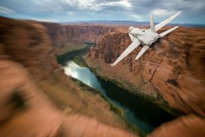 mountains mcdonnell douglas f/a-18 hornet aircraft valley aerial view bird's eye view airplane motion blur river nature canyon clouds sky rock