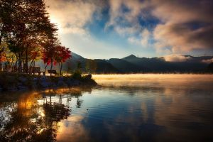 mountains mist water fall reflection clouds nature landscape trees lake