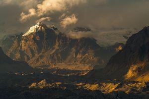 mountains sunlight landscape clouds snowy peak nature sunset
