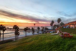 nature branch hotel sea clouds pier landscape lights deck chairs sunset beach evening hills field grass