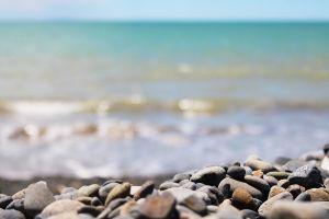 nature depth of field stones beach sea