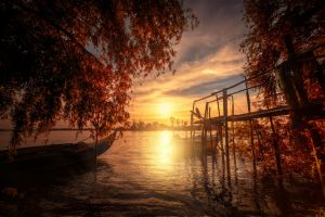 nature dock boat clouds portugal landscape sunset lake trees fall water