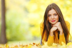 nature leaves red nails women lying on front trees blue eyes face looking at viewer long hair brunette sweater portrait fall yellow clothing