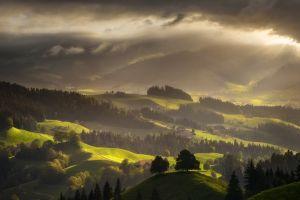nature mountains forest landscape spring green switzerland clouds sun rays mist villages