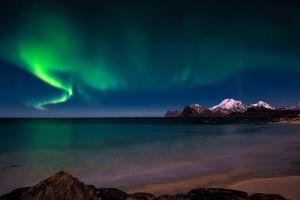 nature sky aurorae night sky water mountains