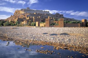 old building morocco people rock landscape architecture palm trees river building nature town water hills stones ruin