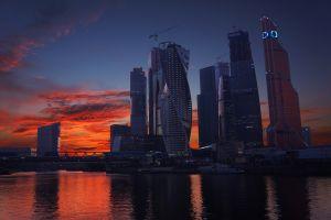 orange sky dusk cranes (machine) skyscraper city moscow