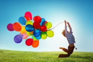 outdoors jumping colorful balloon