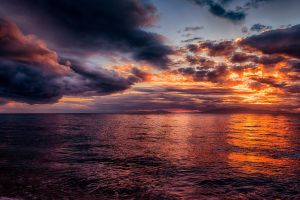 overcast clouds skyscape sea sunset
