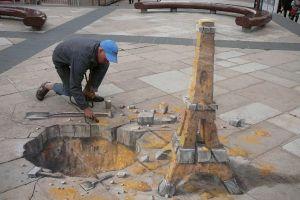 painting street art eiffel tower street men