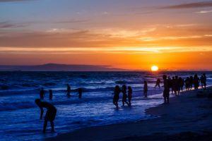 people coast beach sunset sea horizon