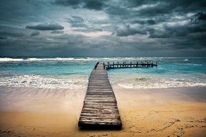 pier beach tropical clouds sea landscape dock sky sand waves nature