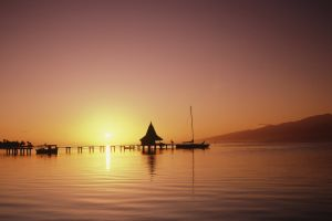 pier mountains boat tropical sea silhouette sunset