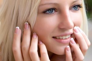 pink nails teeth alysha a blue eyes finger on lips face closeup smiling blonde