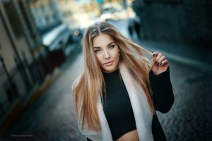 portrait blonde long hair women outdoors holding hair black nails straight hair black tops looking at viewer street view blue eyes public touching hair street black coat