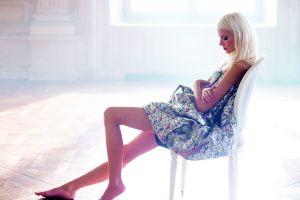 profile women sitting side view platinum blonde dress