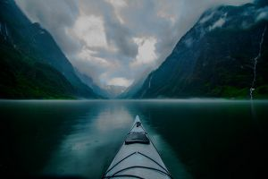 rain kayaks mist landscape norway mountains clouds fjord creeks blue morning nature