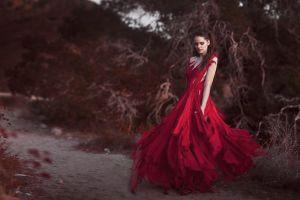 red dress standing brunette dress women model