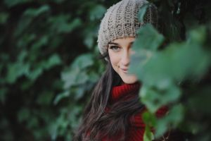 red sweater wool cap brunette scarf sweater long hair nature gray eyes woolen smiling