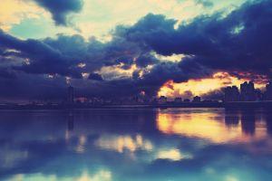 reflection lake clouds city