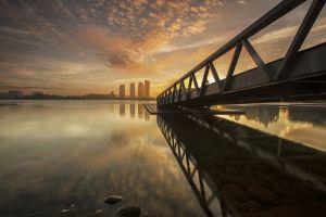 reflection lake skyscraper pier sunset malaysia