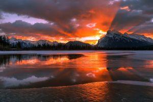 reflection landscape nature pine trees frozen lake mountains sunset canada snow lake forest sun winter alberta ice