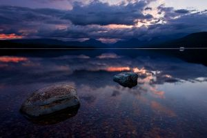 reflection nature calm glacier national park landscape clouds stones lake mountains montana sky water