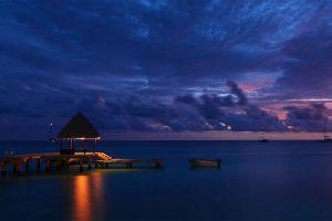 reflection sky landscape clouds tropical water nature beach island sunset dock sea lights