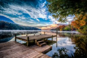 reflection sunset fall lake forest sky trees nature mist pier water landscape mountains clouds