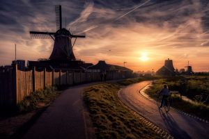 road netherlands building fence clouds path sunset windmill