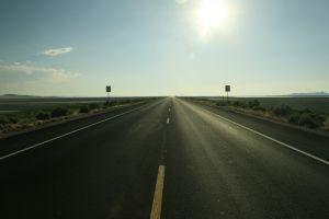 road road sign long road plains photography landscape