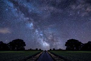 road stars alone milky way landscape field