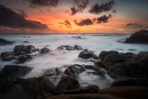 rock coast moody nature sky dark sunlight sunset