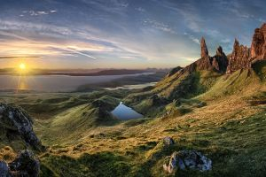 rock old man of storr skye nature grass island scotland sun rays water pond mountains landscape sunlight sea