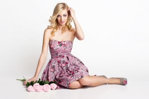 rose dress blonde sitting high heels bare shoulders hands in hair pink dress women blue eyes