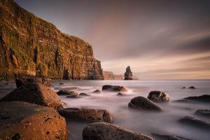 sea cliff mist water nature rock mountains landscape
