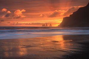 sea vik landscape clouds nature sand sun rays iceland waves beach island glowing sunset rock