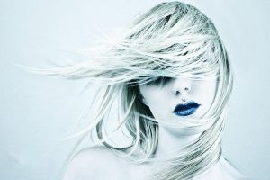 selective coloring women hair   blue lipstick simple background face